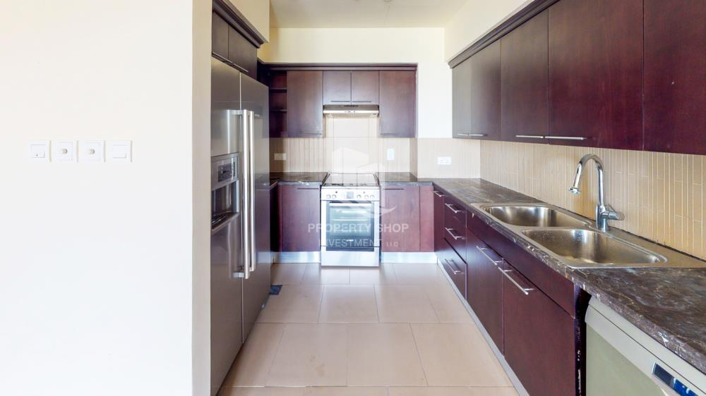 Kitchen-Beautiful and unique living spaces in Saadiyat Beach Residences, 1BR Apt Available for rent! Zero Commission!
