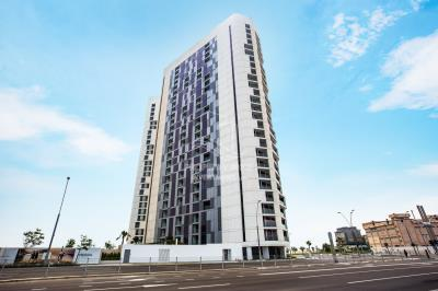 Spacious high floor 1BHK with a balcony, open-kitchen and laundry room available for rent in Meera Tower 2