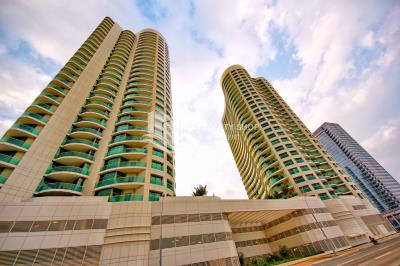 3BR + M with balcony and 2 parking spaces.