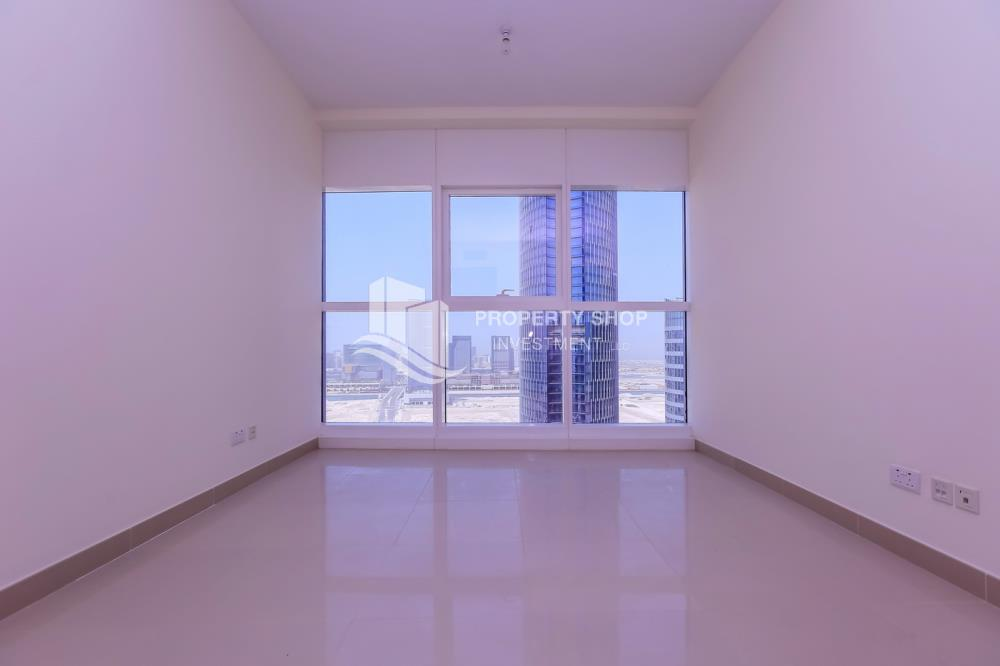 Bedroom-Spacious high-floor 1BHK with a canal view available for rent in Sigma Towers