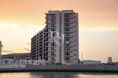 1BR apartment in Water's Edge, Ferrari World view. Selling below original price