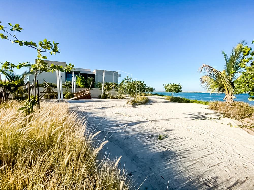 Community-6BR beach mansion with 2 levels.