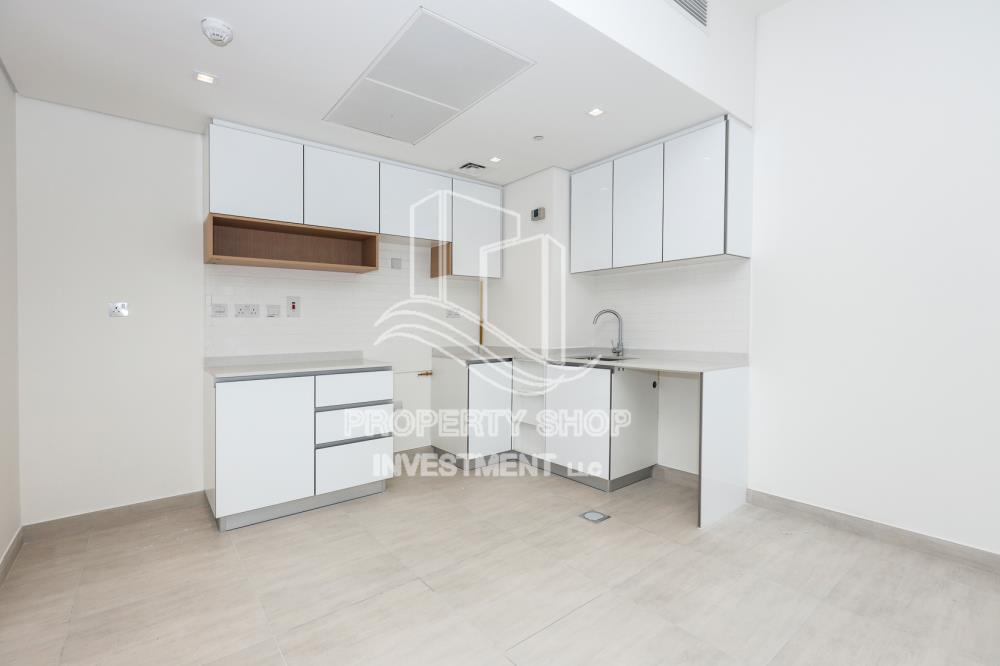 Kitchen-Brand new apartment with pool and sea view in The Bridges, ready for rent immediately!